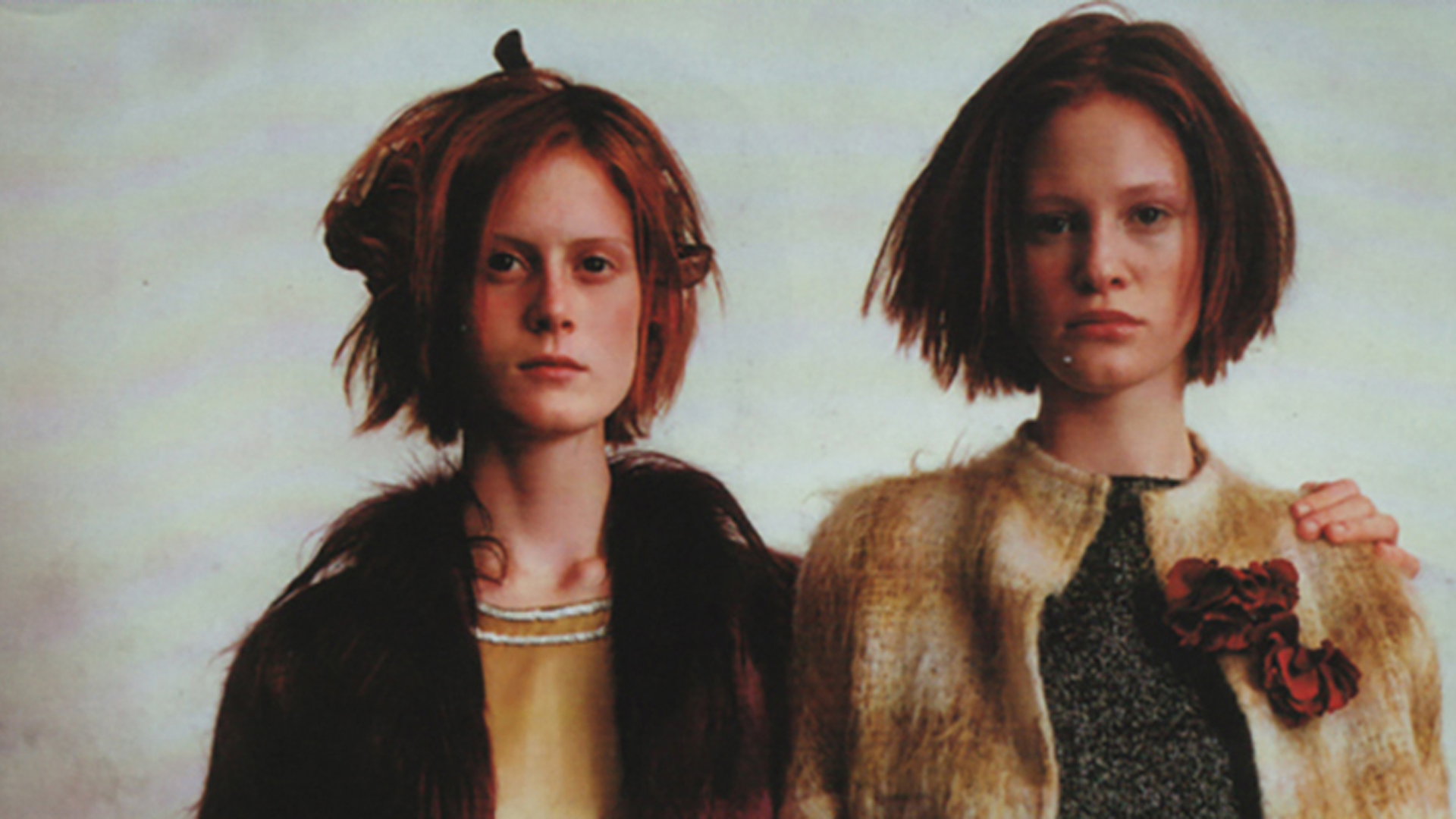 Two models wearing mohair jackets
