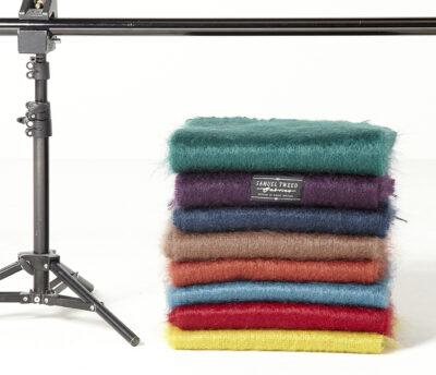 Stack of 8 colours of plain mohair scarves, folded